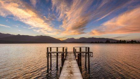 Landscape photo of sunset over Lake Te Anau, Fiordland, New Zealand