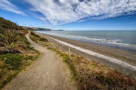 Landscape photo of a hiking and biking trail along Raumati Beach, Kapiti Coast, New Zealand