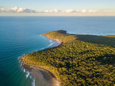 Aerial photo of Tea Tree Bay and Granite Bay at sunset, Noosa National Park, Noosa Heads, Sunshine Coast, Queensland, Australia