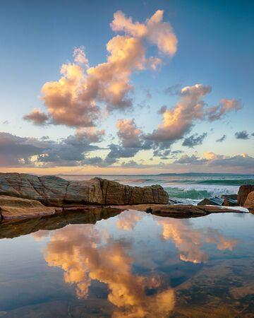 Sunset reflections in rock pools at Tea Tree Bay, Noosa National Park, Noosa Heads, Sunshine Coast, Queensland, Australia Banco de Imagens