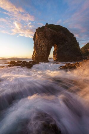 Sunrise at Horse Head Rock, Bermagui, New South Wales, Australia Фото со стока