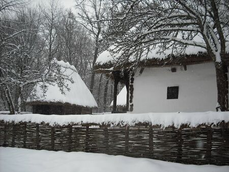 old wooden houses covered with snow on beautiful winter landscape Stock Photo - 7583807