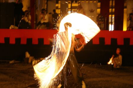 fire show, man in action with fire photo