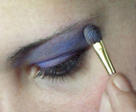 macro shot of woman eye with blue make-up photo