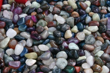 natural background - shiny multi coloured semi precious and ornamental gem stones photo