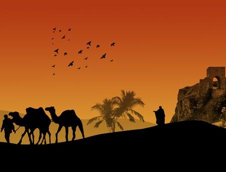 Camellos en el Sahara con los beduinos y el pastor lonley, en puesta del sol anaranjada