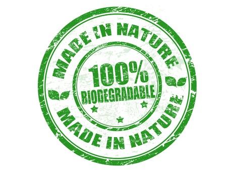 office products: Green grunge sello de goma con el texto en la revista Nature Made - 100% biodegradable en el interior por escrito, ilustraci�n vectorial Vectores