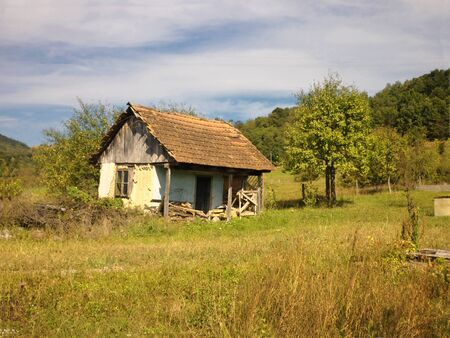 Abandoned old house on autumn landscape photo