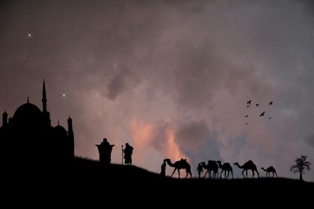 Arabian coucher du soleil avec des bédouins et des chameaux