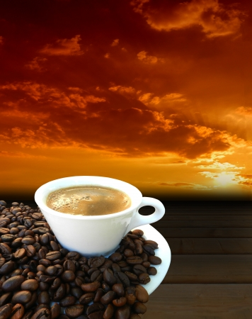 Coffee freshly in white cup and coffee beans on table at sunrise photo