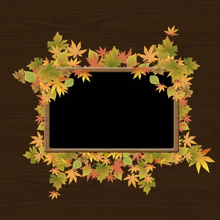 Frame of autumn leaves on wood texture background