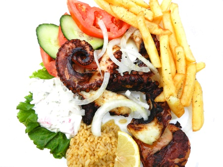 Grilled octopus with  french fries, tomatoes,rice and tzatziki  photo