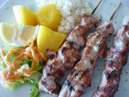 greek food: Souvlaki with onion,tomatoes and french fries