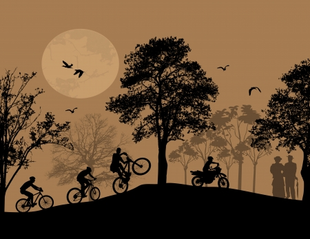 bmx bike: beautiful landscape and cyclists silhouettes