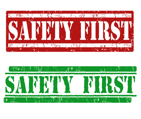 Safety first grunge rubber stamps on white Vector