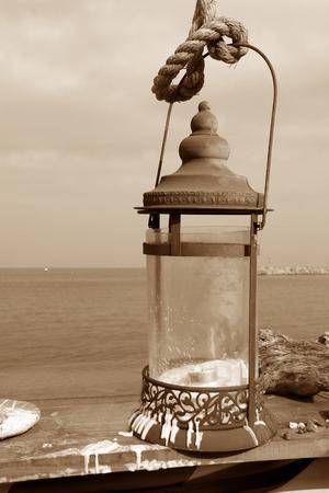 romance sky: Lanterns hang near the sea on sepia tone