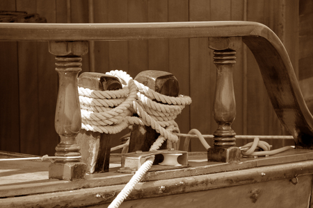 bollards: Ropes and wooden bollards on a sailing ship on sepia tone