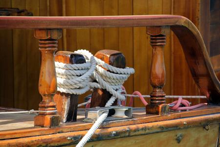 bollards: Ropes and wooden bollards on a sailing ship Stock Photo