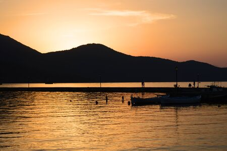 thassos: Sunset at old port in Limenas, Thassos Greece Stock Photo