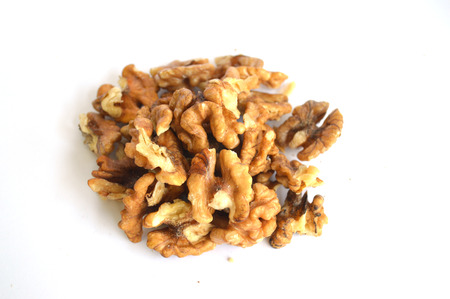 circassian: Stack walnut pieces and halves on a white background