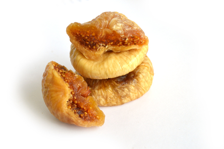 Dried figs on white background