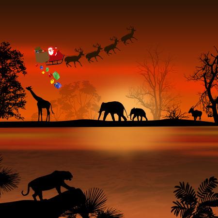 Kerstman in Afrika - silhouetten van wilde dieren en vliegende santa op mooie zonsondergang Stockfoto