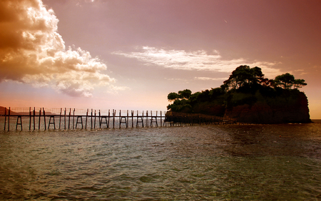 A bridge to the Cameo island at beautiful sunset in Zakynthos island, Greece