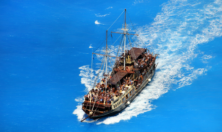 brigg: Pirate style boat ship in the ionian sea blue water, near famous Navagio beach, on  Zakynthos island, Greece Stock Photo