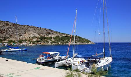 ionian: Yachts in Agios Nikolaos port on Zakynthos island, Greece Stock Photo