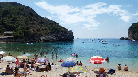 paleokastritsa: PALEOKASTRITSA, GREECE - JULY 20 People on the beach on July 20, 2017, in Paleokastritsa Corfu island, Greece Editorial