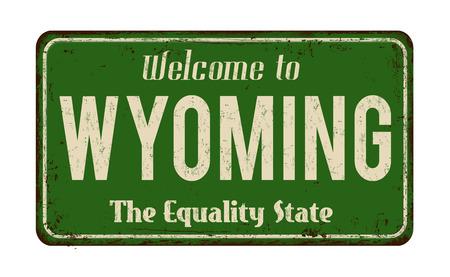 Benvenuto all'illustrazione arrugginita di vettore del segno del metallo dell'annata del Wyoming. Archivio Fotografico - 88965952