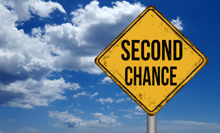 Second chance metallic vintage sign over blue sky with clouds Stockfoto