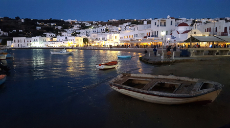 MYKONOS, GREECE - May 18 2016: The old harbor of Mykonos island at night on Greece in May 18 2016. Editorial
