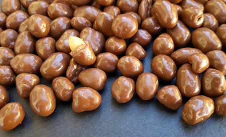 Peanuts in chocolate background texture