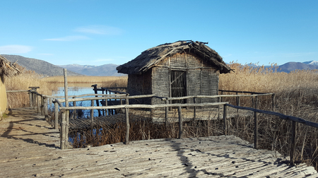 The prehistoric lakeside settlement of Dispilio, near Orestiada lake ( Kastoria, Greece) Stock Photo