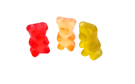 Three colored gummy bears on white background