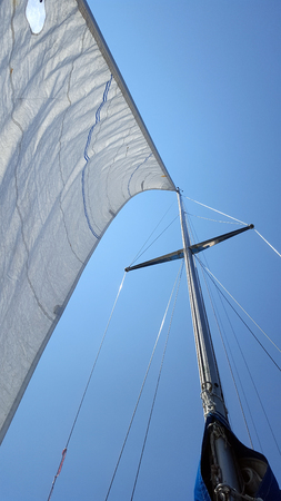 Sail of a sailing yacht in the wind Stock Photo