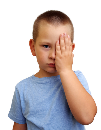 Little boy covering one eye with palm for eyesight exam on white background