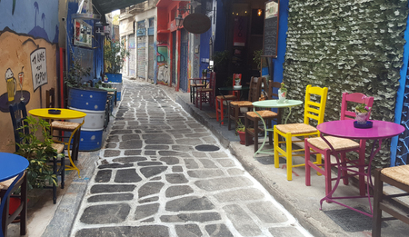 ATHENS, GREECE - 18 October 2016. Street coffee shop with colorful chairs and tables on an alley in Athens, Greece Editorial