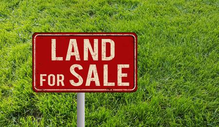 Land for sale metallic vintage sign over green grass, 3D illustration Stockfoto