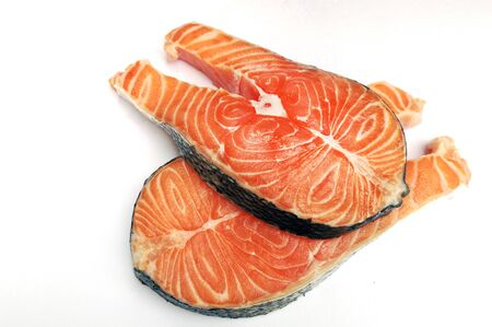 Two salmon steaks close-up on white background