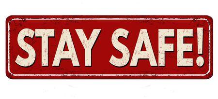 Stay safe vintage rusty metal sign on a white background, vector illustration 向量圖像