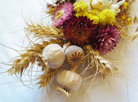 tied in: dried flowers, spikelets, poppy tied in a bouquet for the holiday Stock Photo
