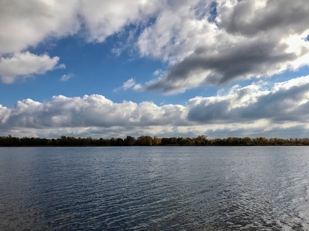 cloudy autumn gray lake in the fog Stock Photo