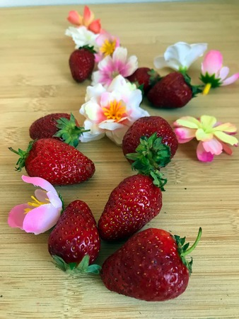delicious strawberry and beautiful flowers on the table