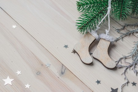 Wooden Christmas decorations - Christmas socks on a white wooden background with a Christmas tree space for text