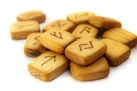 guessing: Old shabby wooden Scandinavian runes for a guessing