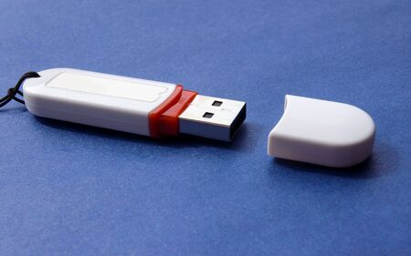 usb flash device, isolated on a dark blue background photo