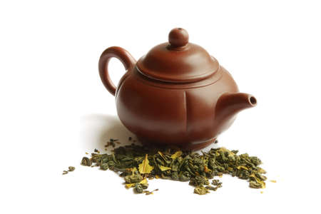 Clay teapot for the Chinese tea and green tea, on a white background