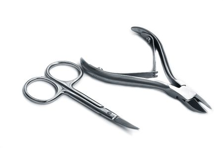 civilized: Steel nippers and scissors for manicure,isolated on white